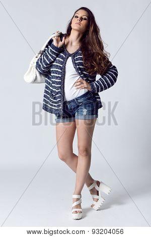 Fashion Portrait Of Pretty Young Woman Posing In The Studio Photo.