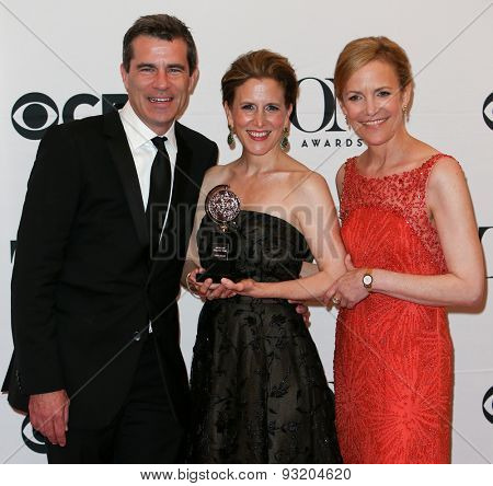 NEW YORK-JUN 7: (L-R) Michael Isaacson, Barbara Whitman and Kristen Caskey hold the trophy at American Theatre Wing's 69th Annual Tony Awards at Radio City Music Hall on June 7, 2015 in New York City.