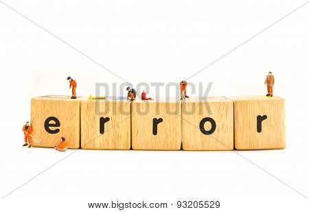 Idea Concept Image Of Mini Figure Dolls Engineer Fixing On Wooden Toy Letter