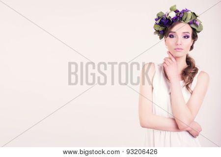 Girl with flower crown posing in studio