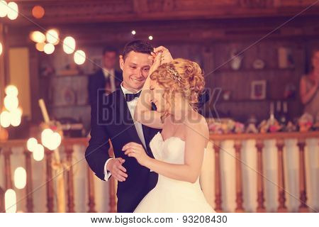 Happy bridal couple dancing