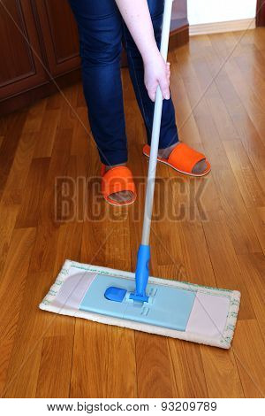 Housewife Washes Floor Of Mop