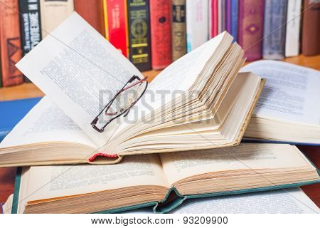 A Lot Of Open Books On The Desk