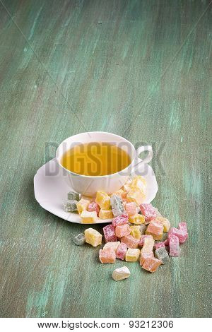 Tea In A White Cup And Saucer, A Scattering Of Turkish Delight