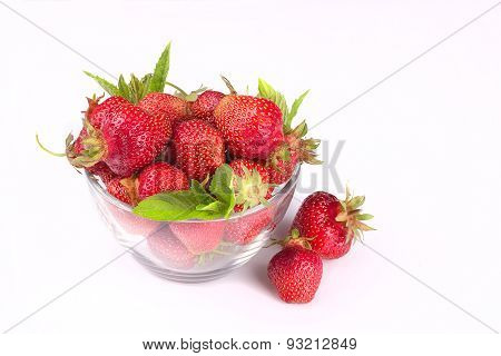 Strawberry And Mint On A White Background In A Glass Bowl