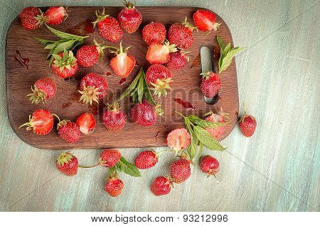 Strawberry Loose On A Wooden Kitchen Boards