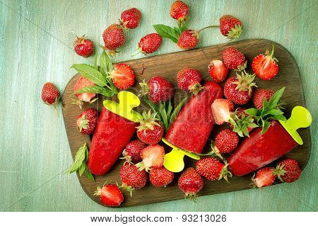 Strawberries, Strawberry Ice Cream On A Wooden Board, Strawberries Scattered On The Board