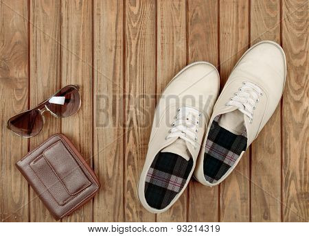 Pair Of Beige Shoes On Wooden Background
