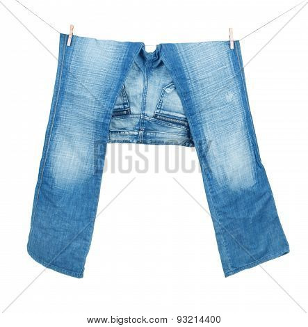 Blue Jeans On Washing Line Isolated On White