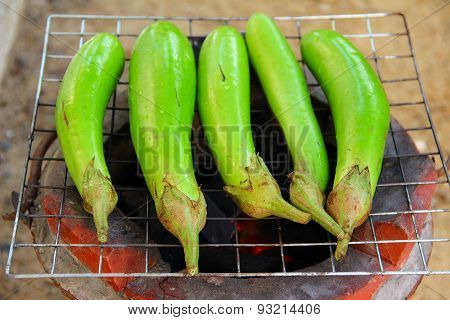 Fresh green eggplants on old style stove