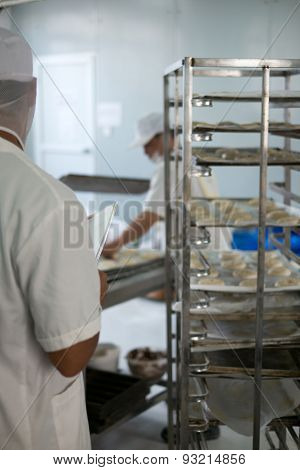 Bakers Counting Stock At Bakery