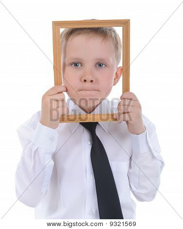 Little Boy With A Wooden Frame In His Hands.