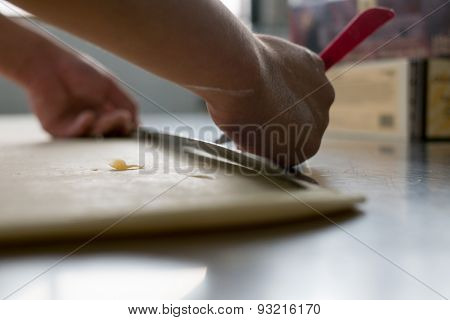 Freshly Made Croissant Dough Being Hand Cut