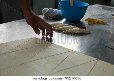 Cutting Dough Into Croissants