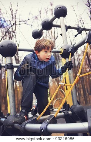 Preteen Handsome Boy Train In Outdoor Gym Training Ground.