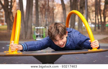 Preteen Handsome Boy Play In Outdoor Gym Training Ground