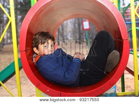 Preteen Handsome Boy On The Slide Playground