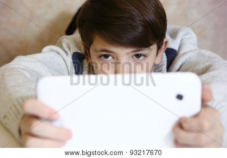 Boy With Pad Playing Game