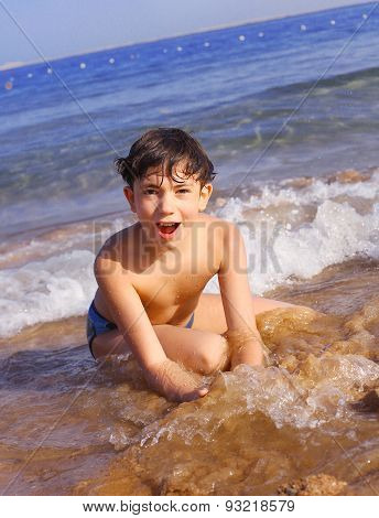 Preteen Handsome Boy Swimming On The Red Sea Beach