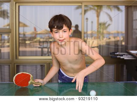 Preteen Handsome Boy Play Table Tennis In The Beach Resort Hotel Recreation Area