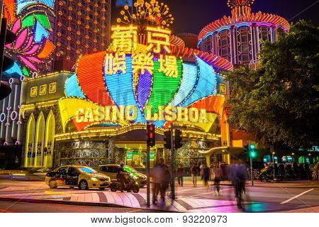 MACAU, CHINA - OCTOBER 12, 2012: Crowds and traffic pass the exterior of Casino Lisboa. Macau is the world's top casino market and Casino Lisboa is one of the most well known casinos in the city.