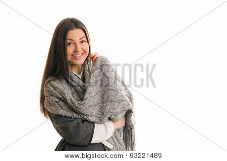 A Girl In A Gray Knitted Scarf Smiling.