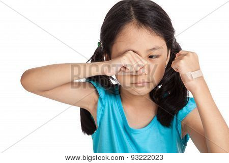 Little Asian Girl Cry With Bandage On Her Hand