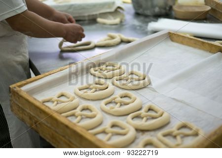 Baker Making Mirrored Pretzel