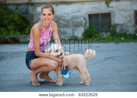 Beautiful Young Woman On A Walk With Cute Poodle Dog
