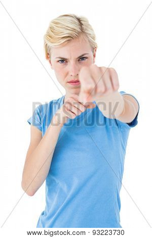 Stern blonde woman pointing with her finger on white background