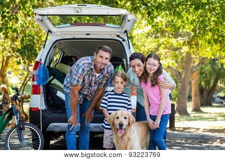 Happy family getting ready for road trip on a sunny day