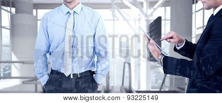 Businessman looking at the camera against airport terminal