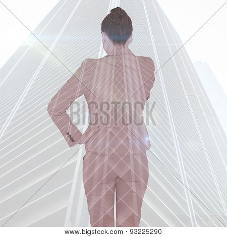 Asian businesswoman pointing against low angle view of skyscraper