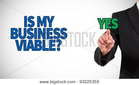 Businessman standing and pointing against white background with vignette