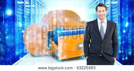 Smiling businessman standing with hands in pockets against digitally generated black and blue matrix