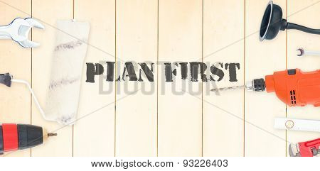 The word plan first against diy tools on wooden background