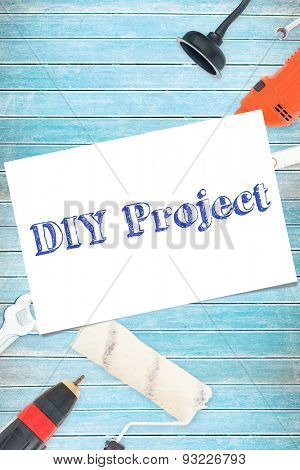 The word diy project and white card against tools on wooden background