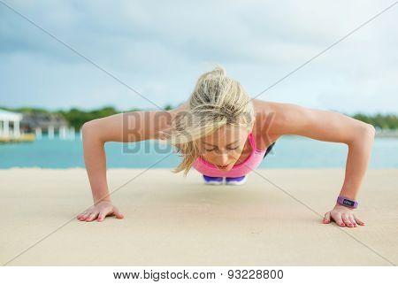 Woman doing pushups exercise
