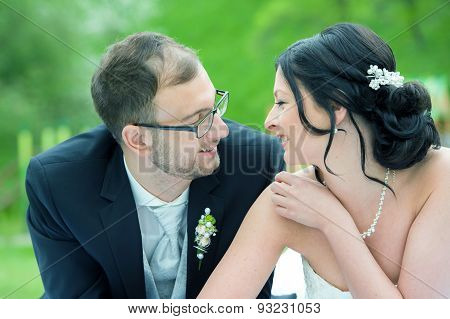 Young Bridal Couple  In Front Of Nature Background