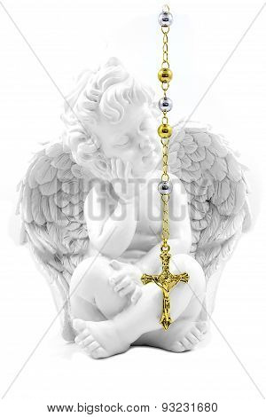 Crucifix, rosary and angel
