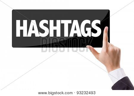 Businessman pressing button with the text: Hashtags
