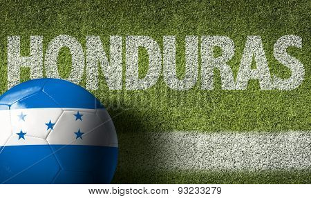 Soccer field with the text: Honduras
