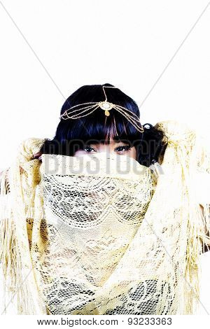 African American Woman Using Golden Shawl As Veil