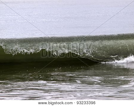 Close Shot Of Ocean Wave Curling Over
