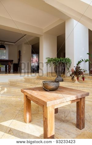 Wooden Table In Designed Interior