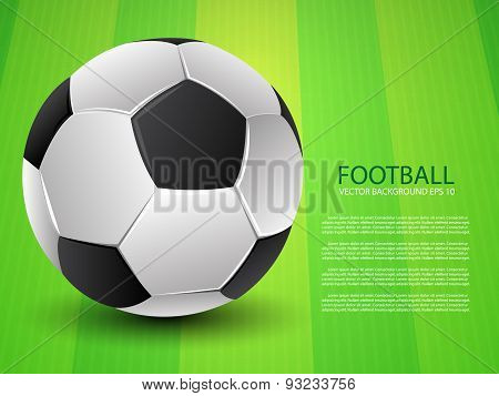 Football (soccer) ball on green field background
