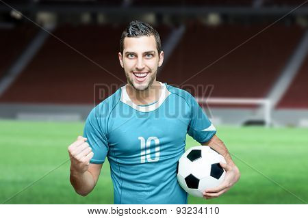Uruguayan fan celebrates on stadium background