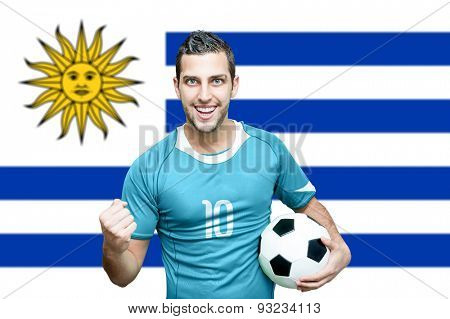 Uruguayan fan celebrates on Uruguay flag background