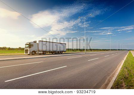 White Truck On Freeway At Idyllic Sunny Day