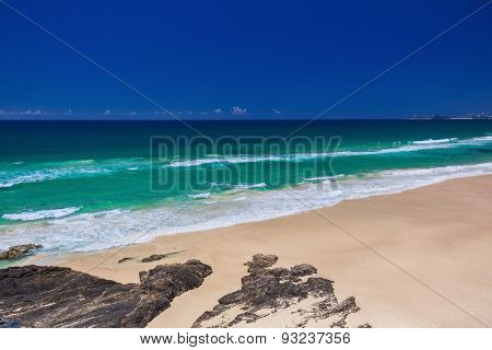 Tropical beach with surf waves on Gold Coast, Queensland, Australia